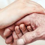 caregiver holding hands care family