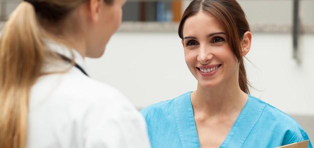 nurse talks to doctor
