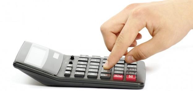 calculator hand pressing