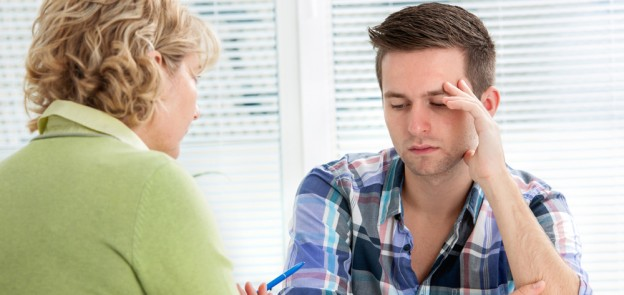depressed man talking to woman