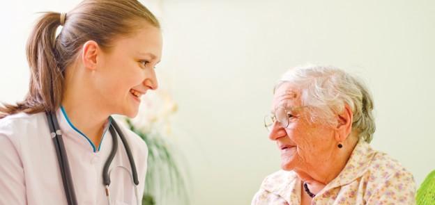 nurse and old lady talk