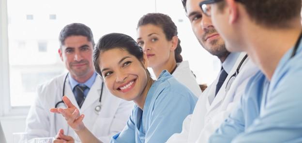 nurse smiling at doctors