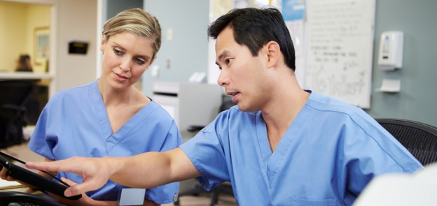 nurses with iPad at station