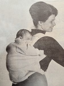 Ann Moore with baby in Snugli.